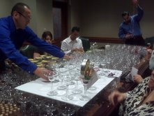 Ruiz and other volunteers putting the margarite glass invitations together